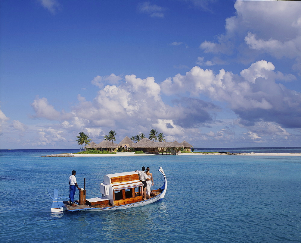 Couple ariving at the Four Seasons Spa in the Maldives, Indian Ocean, Asia