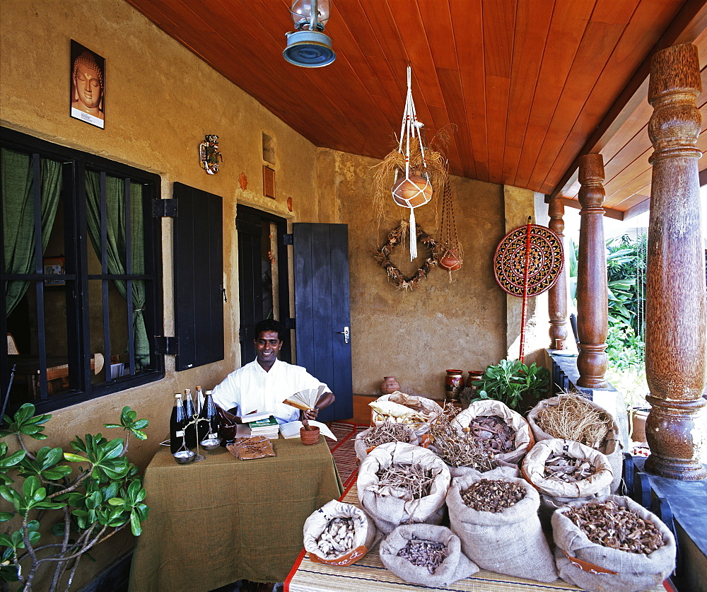 Ayurvedic doctor in displaying herbal medicines, Sri Lanka, Asia