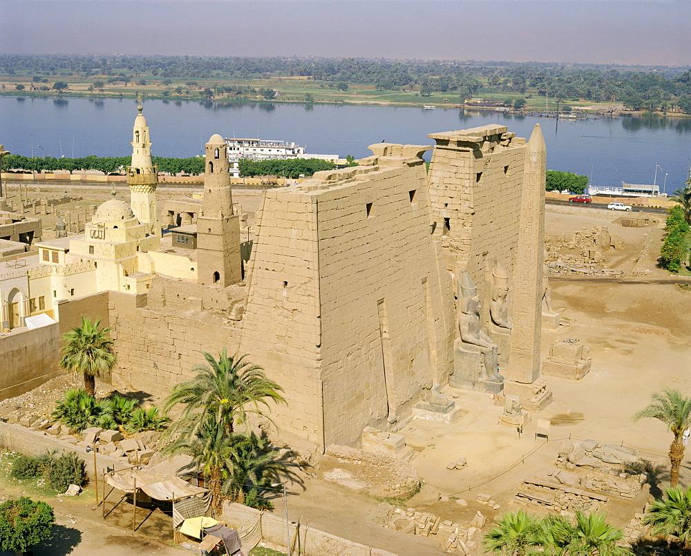 Aerial view over the Temple of Luxor and the Abu el-Haggag Mosque, an Islamic building inside an ancient Egyptian temple beside the River Nile, Luxor, Thebes, Egypt, North Africa, Africa