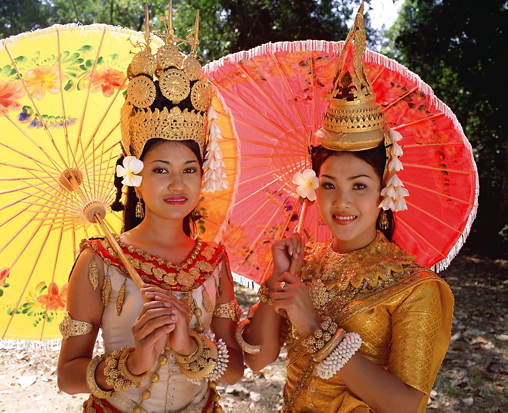 Head and shoulders portrait of two traditional Cambodian apsara dancers, smiling and looking at the camera, at Angkor, Siem Reap Province, Cambodia, Indochina, Southeast Asia, Asia