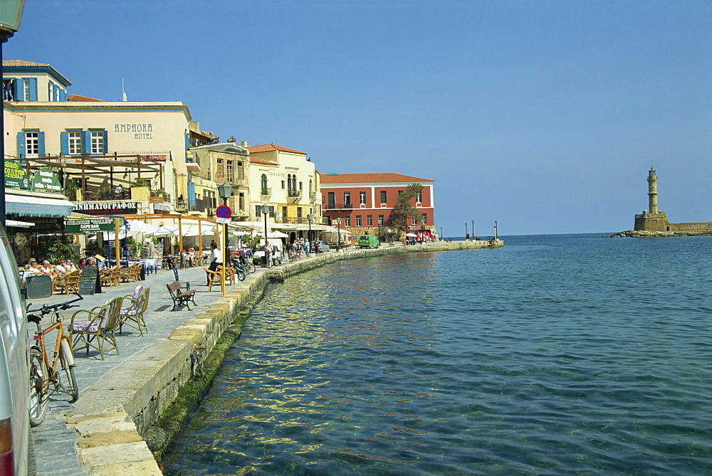 The harbour waterfront and the Venetian lighthouse, Chania, Crete, Greece, Europe