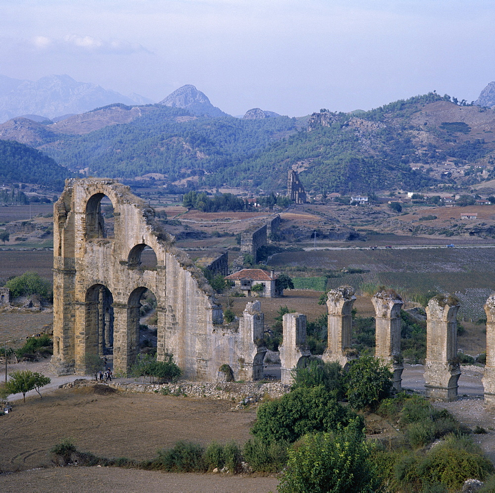 Ruins of Roman aqueduct which brought water from mountains to the city on a hill, illustrating Roman knowledge of water physics, archaeological site, Aspendos, Anatolia, Turkey, Asia Minor