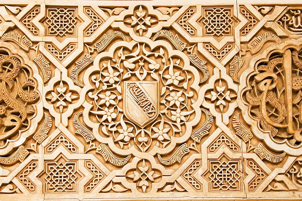 Atauriques (Moorish plaster work) in the Nasrid palace showing the shield of al Ahmur used as a decorative theme, Alhambra, UNESCO World Heritage Site, Granada, Andalucia, Spain, Europe - 253-3636