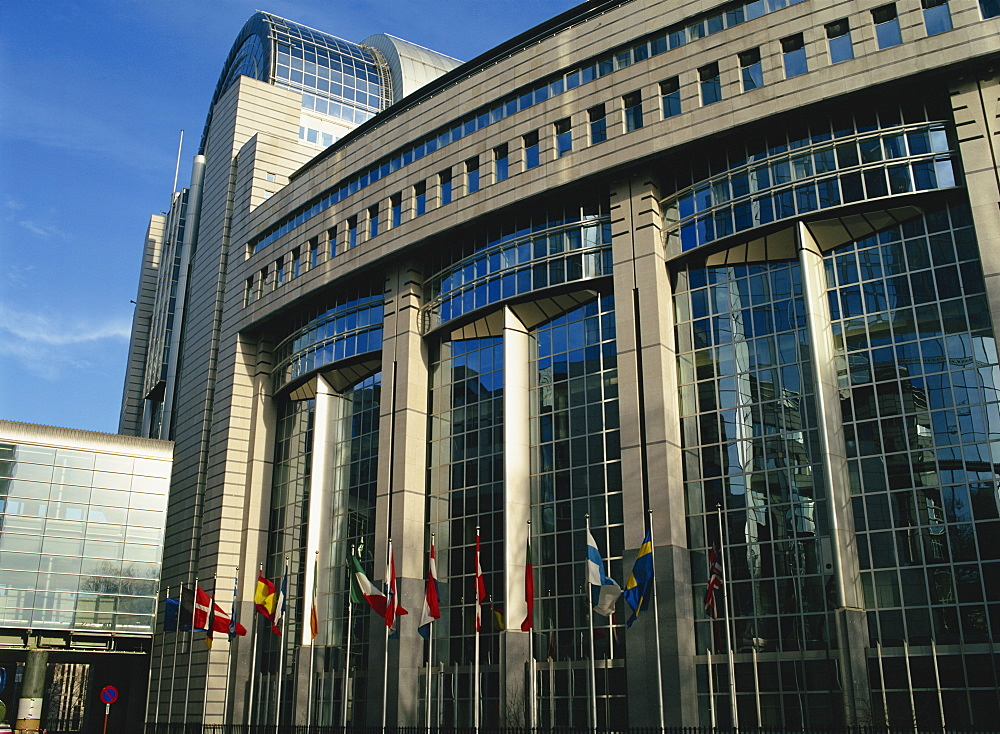 Flags outside the European Commission and Parliament Buildings in Brussels, Belgium, Europe