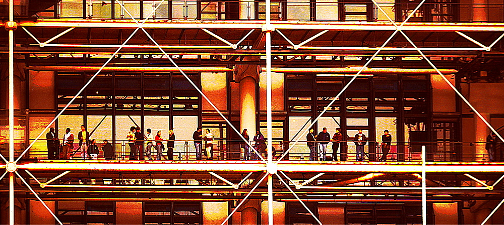 People standing on a balcony outside the Pompidou Centre, Paris, France
