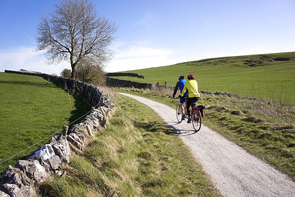 Couple on a tandem on the High Peak Trail, Peak District National Park, Derbyshire, England, United Kingdom, Europe - 255-8981