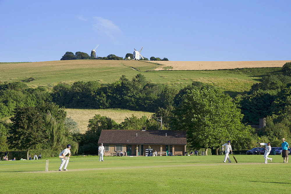 Cricket match and the Jack and Jill windmills at Clayton, seen from the South Downs Way, Sussex, England, United Kingdom, Europe