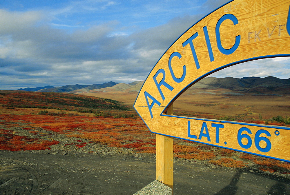 Arctic Circle crossing point on road across tundra, Dempster Highway, Yukon, Canada - 29-1561