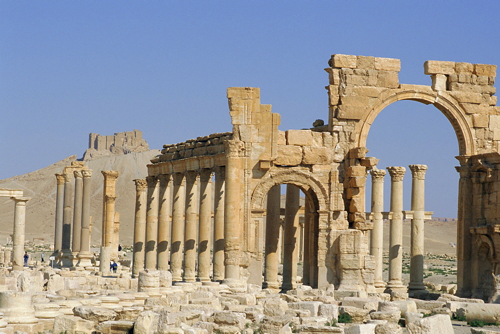 Triumphal Arch, colonaded street of Roman city, Palmyra, Syria, Middle East