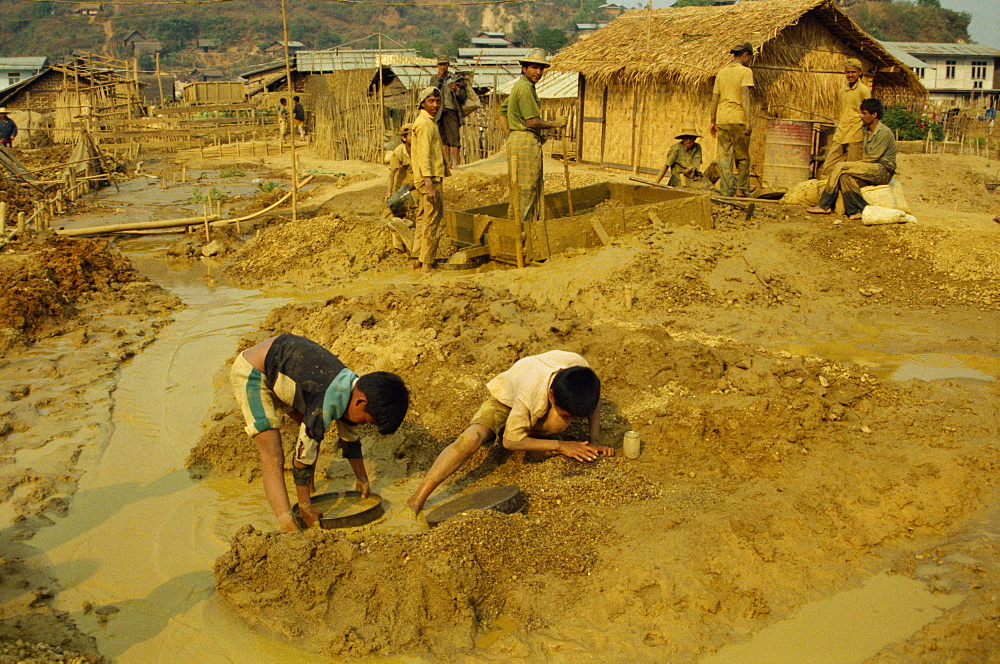 Children sieving and washing small gems from mine waste, Mogok ruby mines, near Mandalay, Myanmar (Burma), Asia