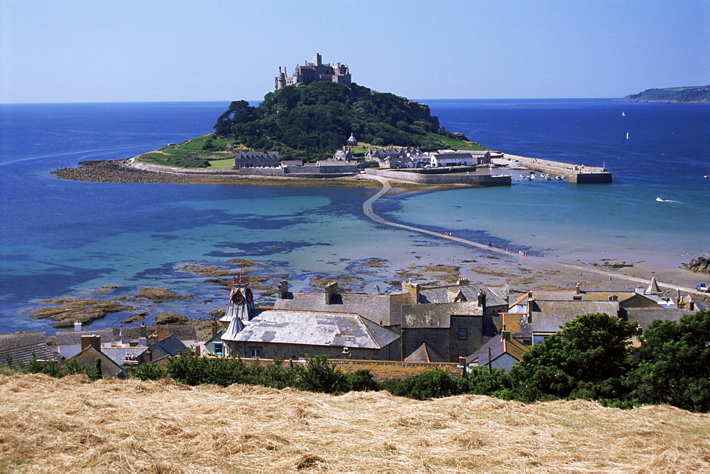 Submerged causeway at high tide, seen over rooftops of Marazion, St. Michael's Mount, Cornwall, England, United Kingdom, Europe