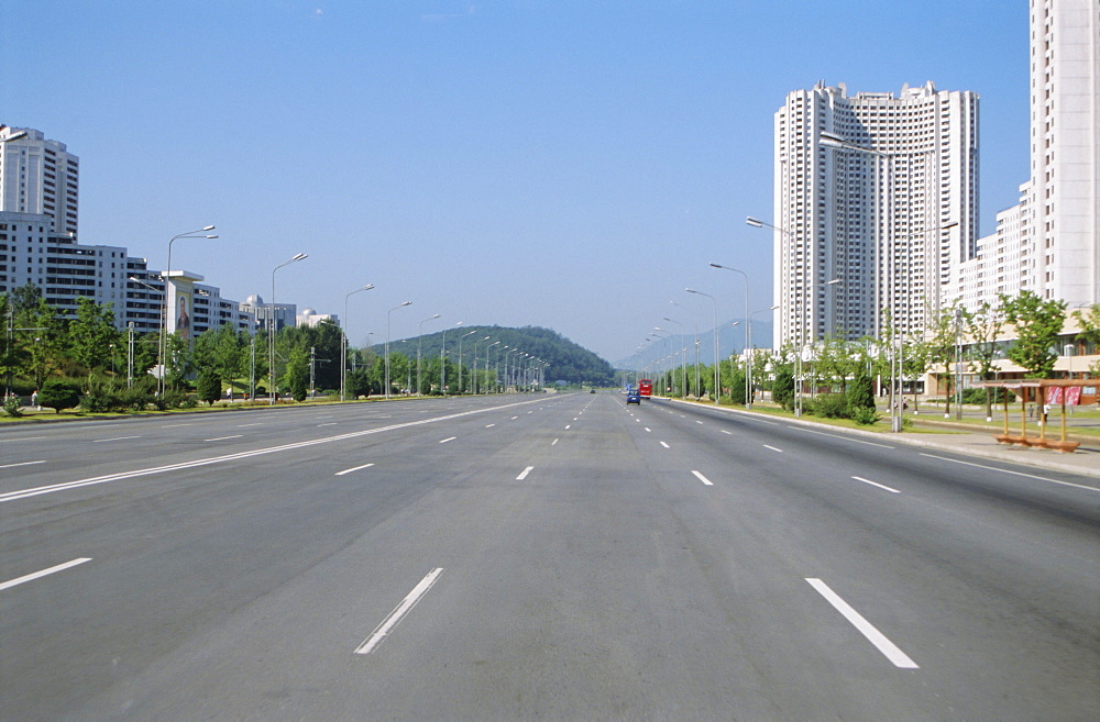 Blocks of flats beside road to Nampo, ten lanes wide but no traffic, Pyongyang, North Korea, Asia
