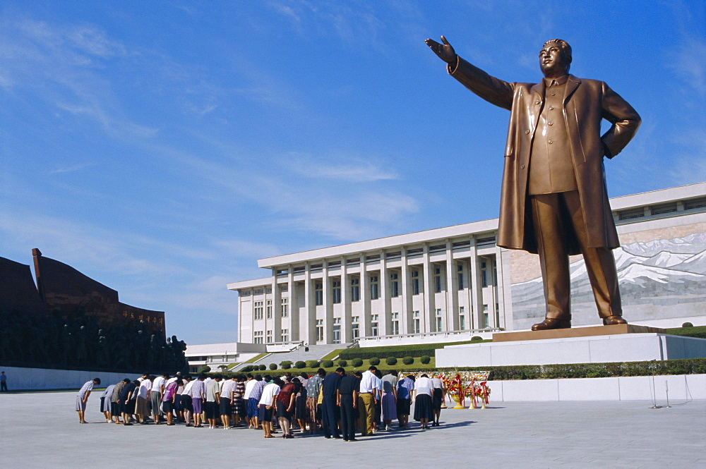 Commune group brought to bow to Great Leader on Grand Monument, Pyongyang, North Korea, Asia