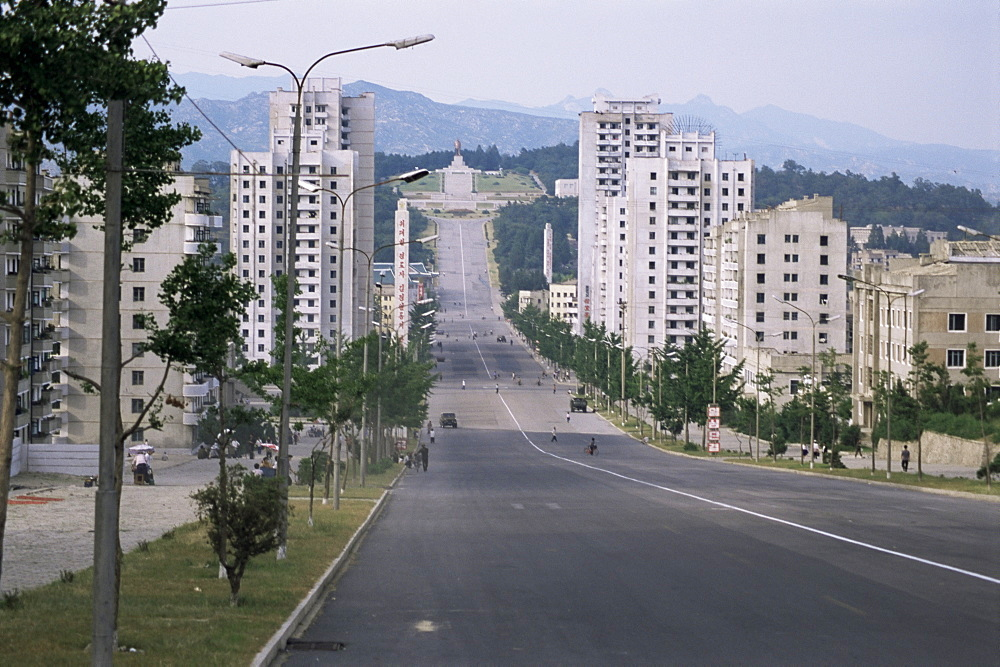 High-rise flats and over-sized street, with lack of traffic, Kaesong, North Korea, Asia
