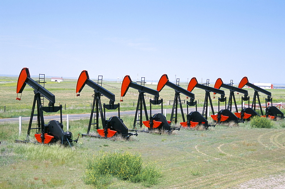 Oil pumps (nodding donkeys) for sale at oilfield supply merchants, Shelby, Montana, United States of America, North America