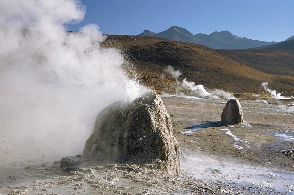 Active geysers on geyserite domes, El Tatio geyser basin on altiplano, Atacama Desert, Chile, South America