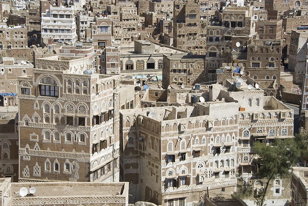 Traditional ornamented brick architecture on tall houses in Old City, Sana'a, UNESCO World Heritage Site, Yemen, Middle East
