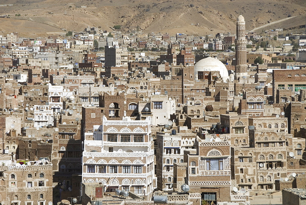 Traditional ornamented brick architecture on tall houses, Old City, within Sana'a, UNESCO World Heritage Site, Yemen, Middle East