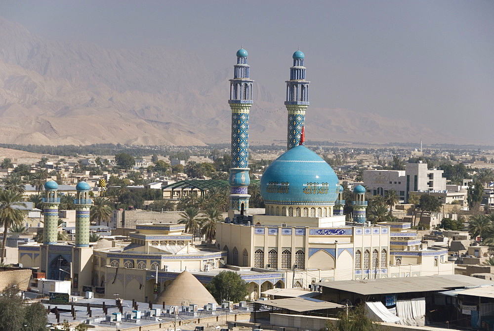 Minarets and dome of main mosque centre of desert town, Lar city, Fars province, southern Iran, Middle East