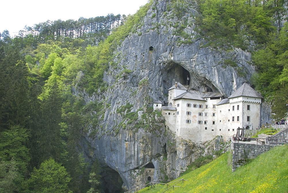 Predjama Castle, built in mouth of cave, near Postojna, Slovenia, Europe