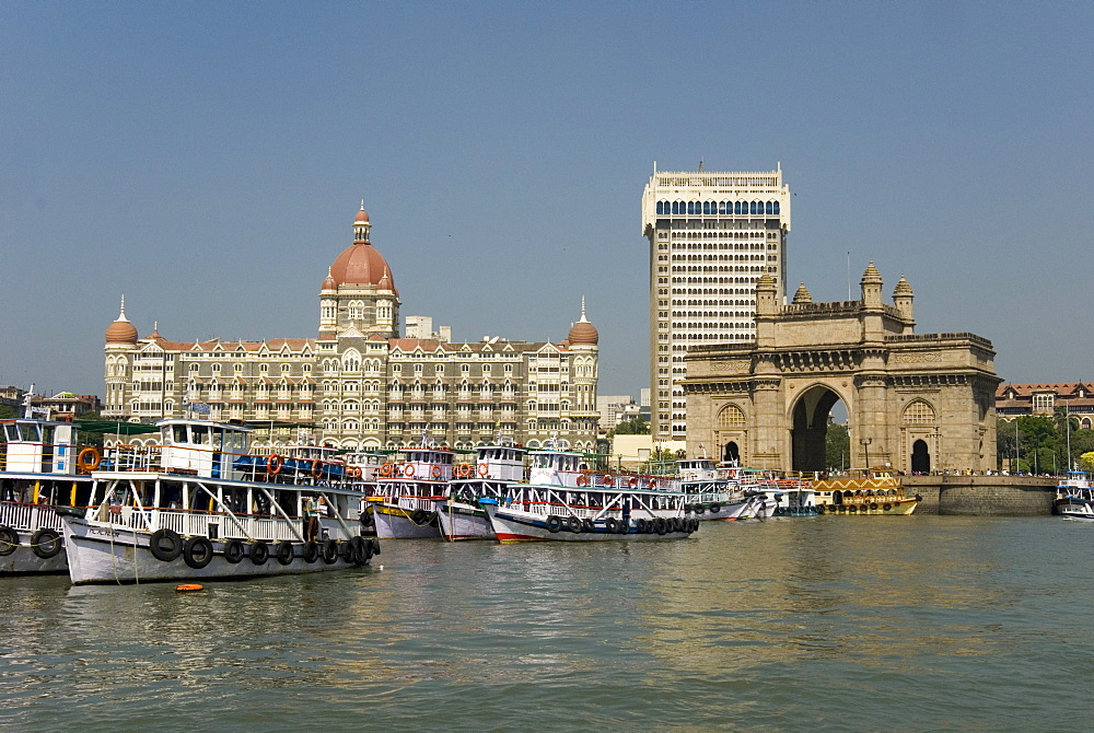 Gateway of India on the dockside beside the Taj Mahal Hotel, Mumbai, India, Asia