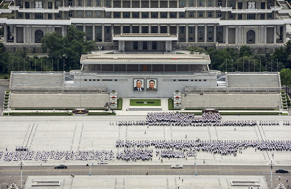 Kim Il Sung Square, hordes of young people rehearsing marching routines prior to a grand parade, Pyongyang, North Korea, Asia - 29-5496
