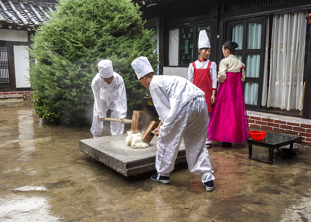 Traditional rice smashing at Kaesong, North Korea, Asia - 29-5506