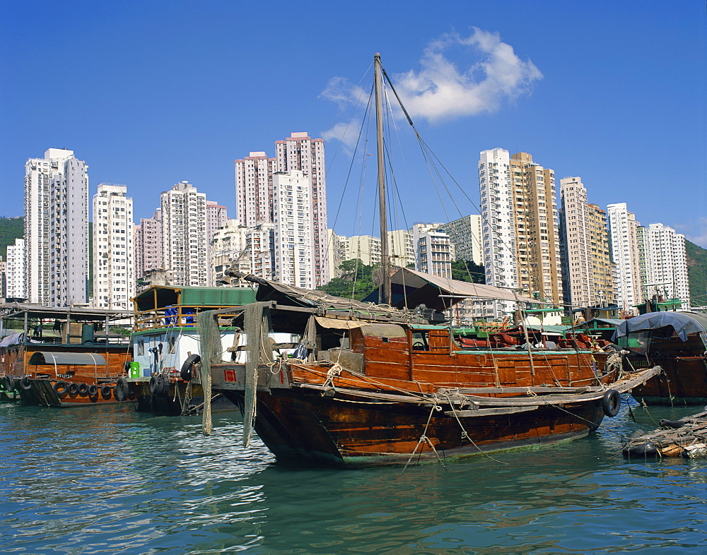 Boats in the harbour and high rise apartment buildings in the background at Aberdeen, Hong Kong, China, Asia