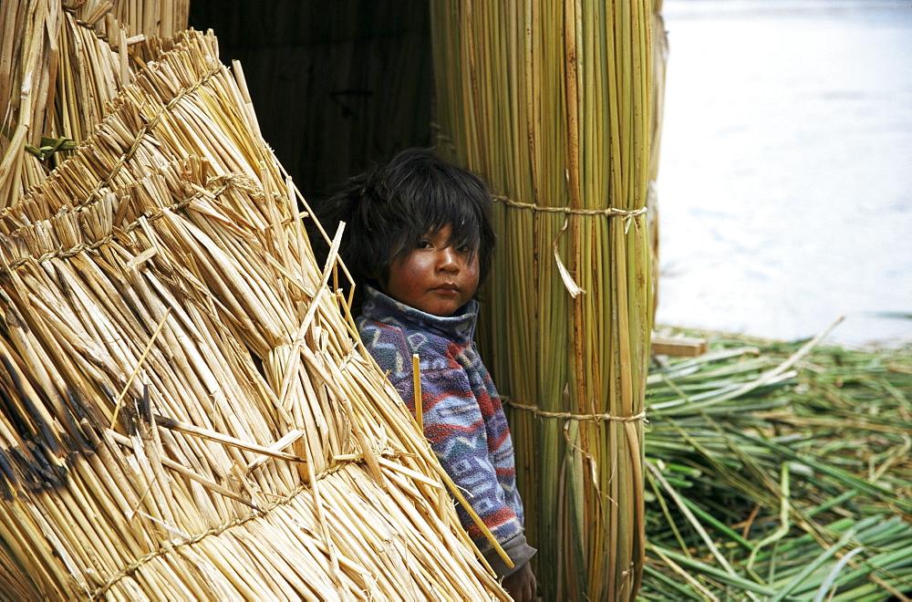 Little boy, Uros floating reed island, Lake Titicaca, Peru, South America