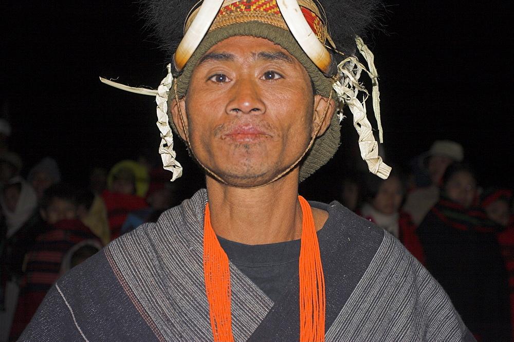 Naga man dancing at Grand Finale wearing headdress of woven cane decorated with wildboars teeth and bear fur, Naga New Year Festival, Lahe village, Sagaing Division,  Myanmar (Burma), Asia