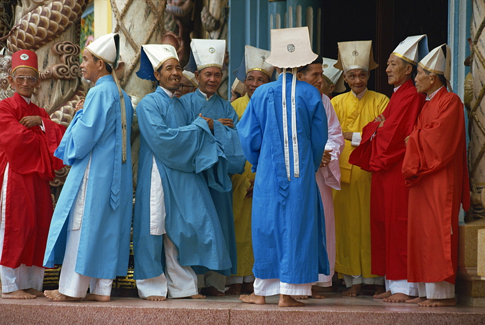 A group of Caodist dignitaries in ceremonial dress at the Cadai Great Temple at Tay Ninh, Halong Bay, Vietnam, Indochina, Southeast Asia, Asia