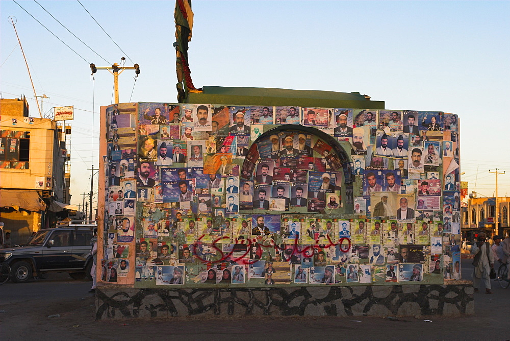 Pictures of election candidates stuck on building in midddle of street, Herat, Herat Province, Afghanistan, Asia