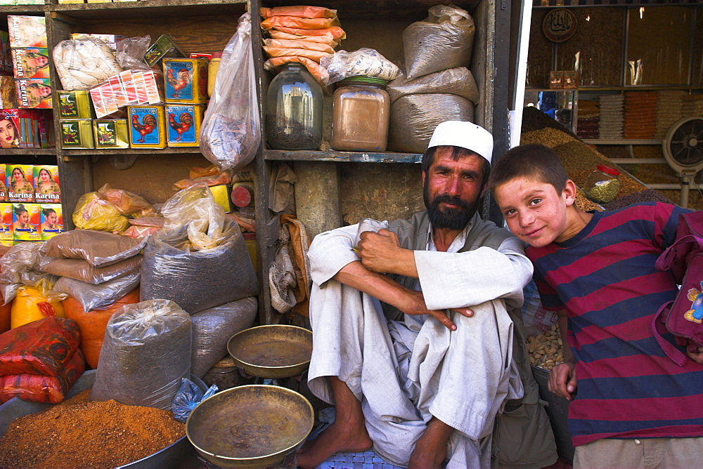 Shop keeper and boy in spice shop, bazaar, central Kabul, Afghanistan, Asia