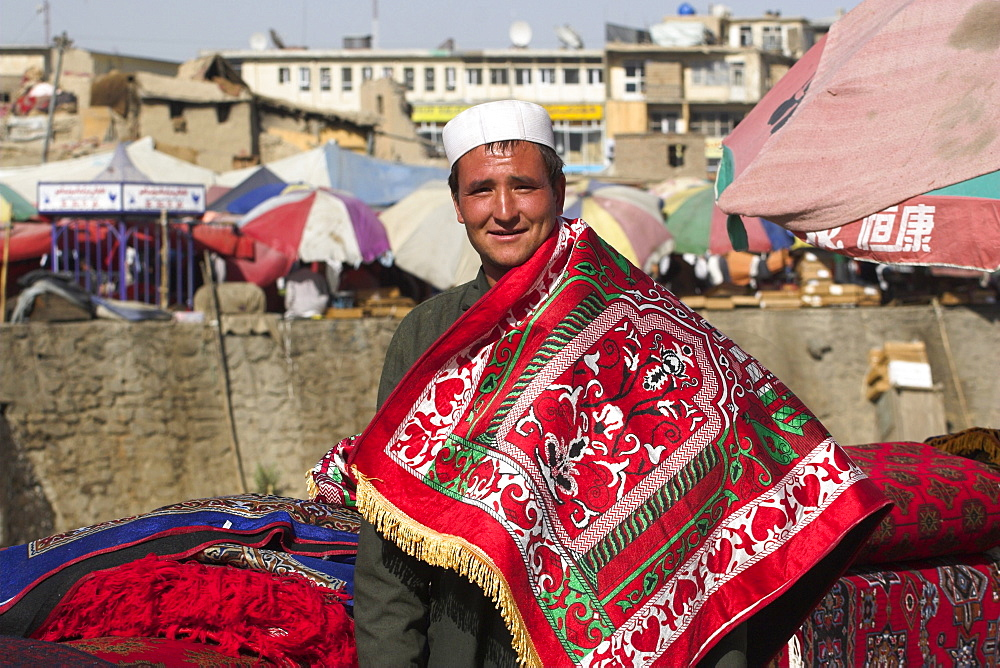Man selling rugs on banks of Kabul river, Central Kabul, Afghanistan, Asia