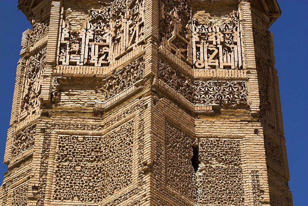 One of two early 12th century minarets built by Sultan Mas'ud 111 and Bahram Shah, that served as models for the Minaret of Jam, decorated with square Kufic and Noshki script, Ghazni, Afghanistan, Asia
