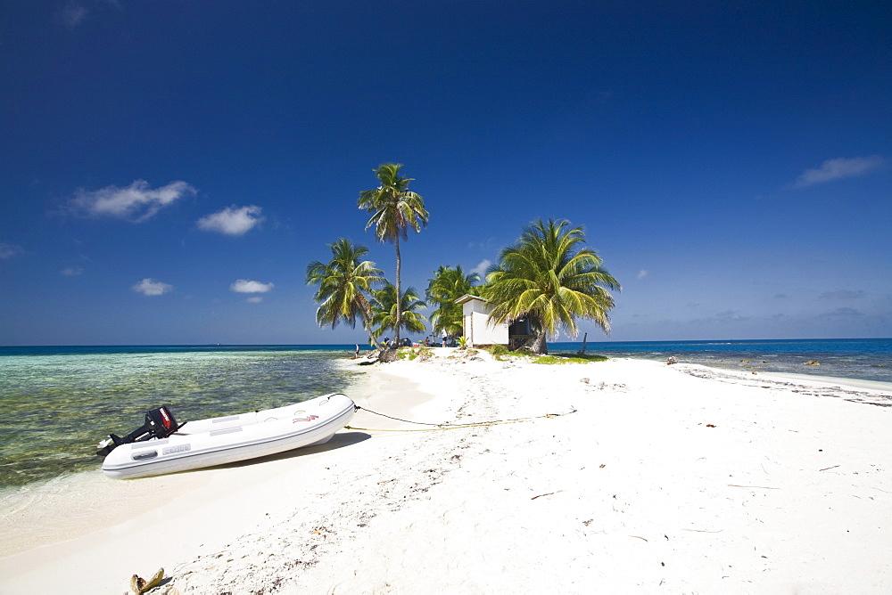 Dinghy on beach, Silk Caye, Belize, Central America