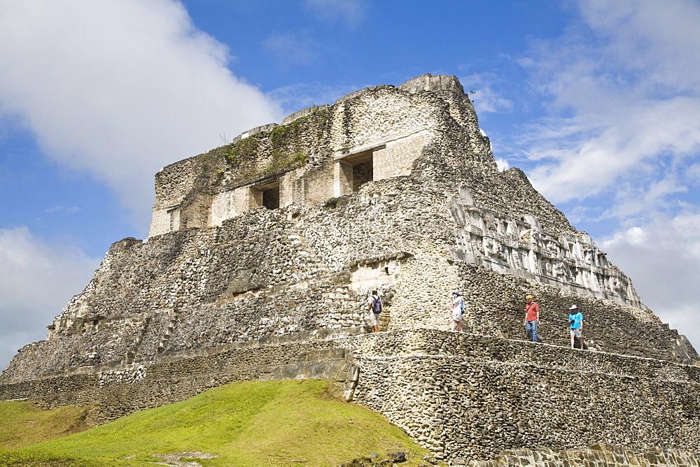 Tourists on the 130ft high El Castillo, Xunantunich Ruins, San Ignacio, Belize, Central America