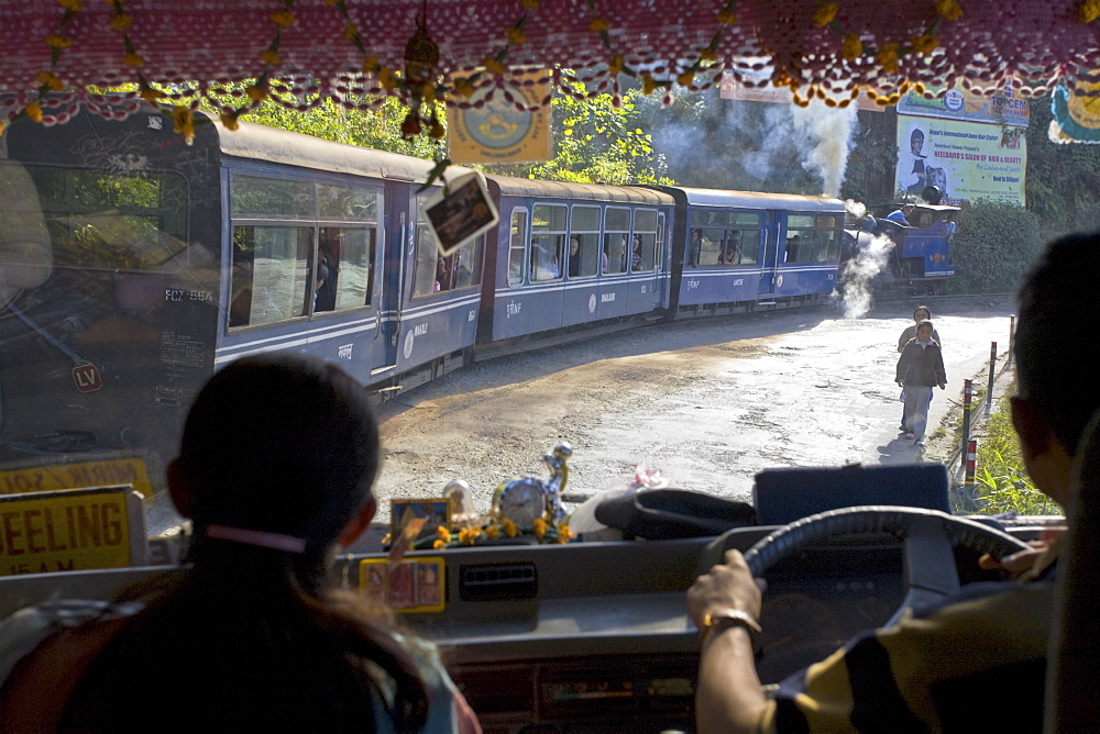 View looking through windscreen of bus at Steam train (Toy Train), Darjeeling, West Bengal, India, Asia