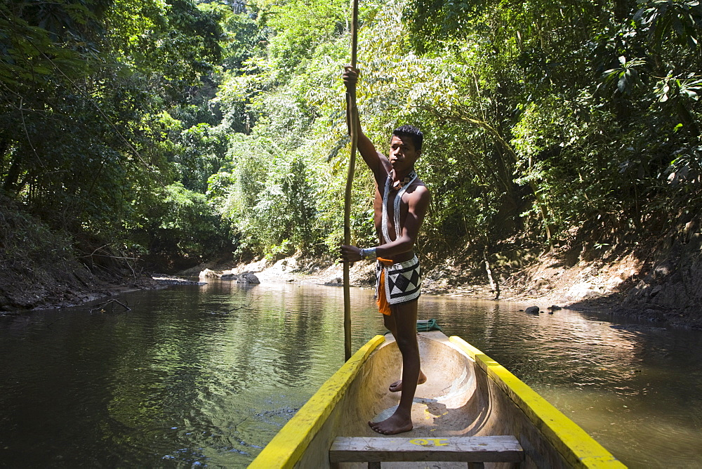 Embera Indian man in dugout canoe on Chagres River, Panama, Central America