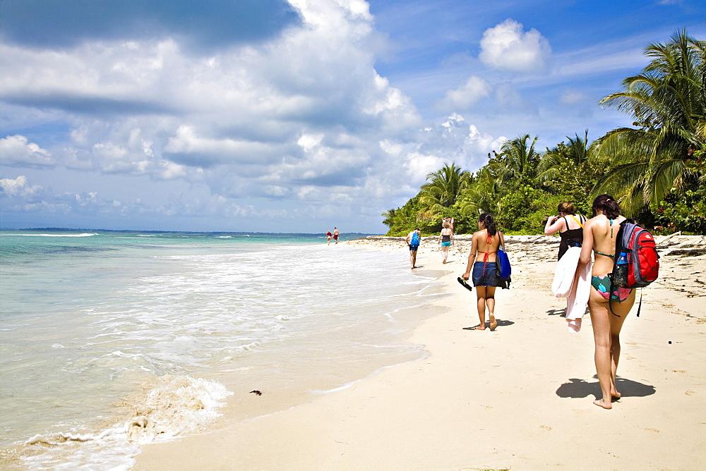 Tourists walking along beach, Zapatillas Island (Cayes Zapatillas), Bocas del Toro Province, Panama, Central America