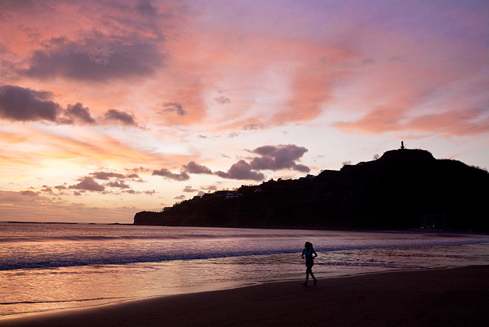 Woman walking along beach, San Juan Del Sur, Nicaragua, Central America