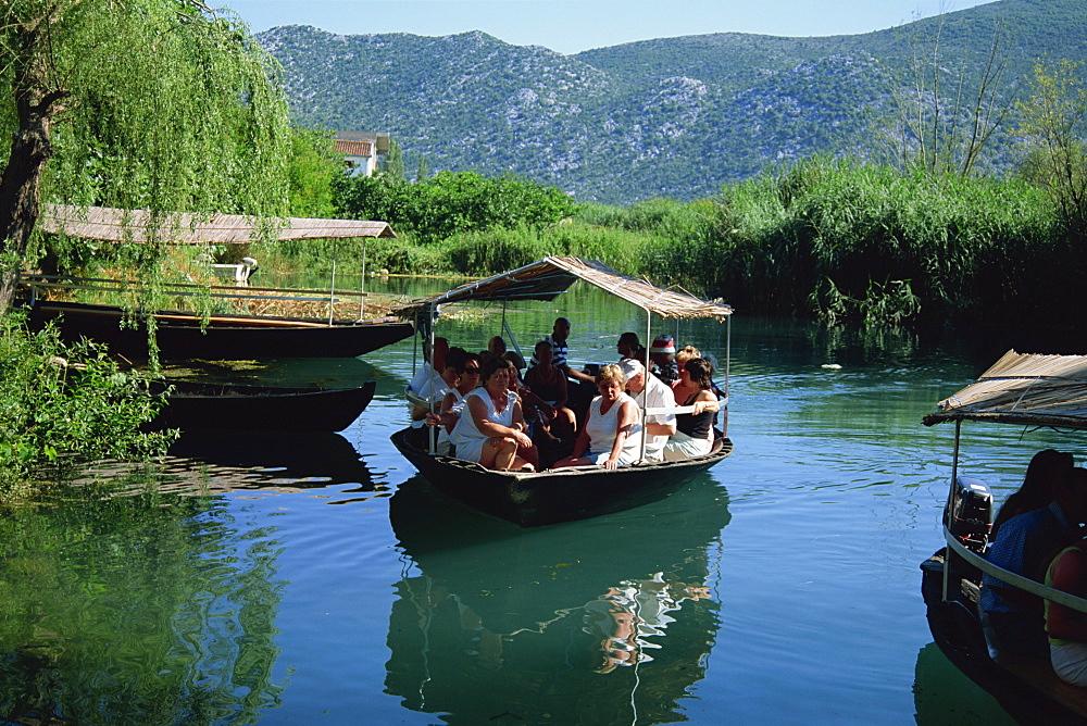 Tourists in local boats, Neretva Delta Valley, Croatia, Europe - 314-3732