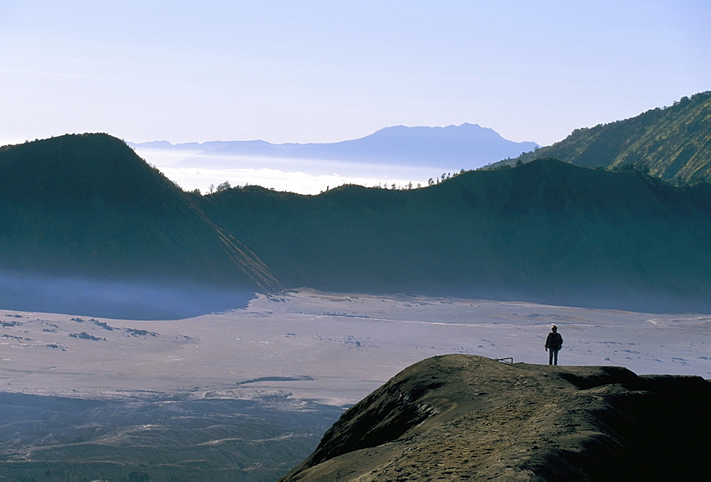Tourist walking along rim of Gunung Bromo, Bromo-Tengger-Semeru National Park, Java, Indonesia, Southeast Asia, Asia
