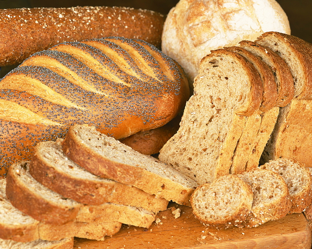 A selection of bread loaves and bread slices