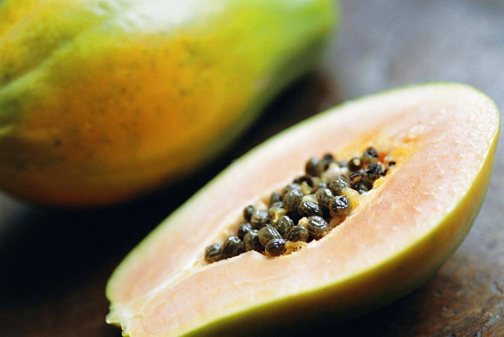 Papaya (pawpaw) sliced open to show black seeds