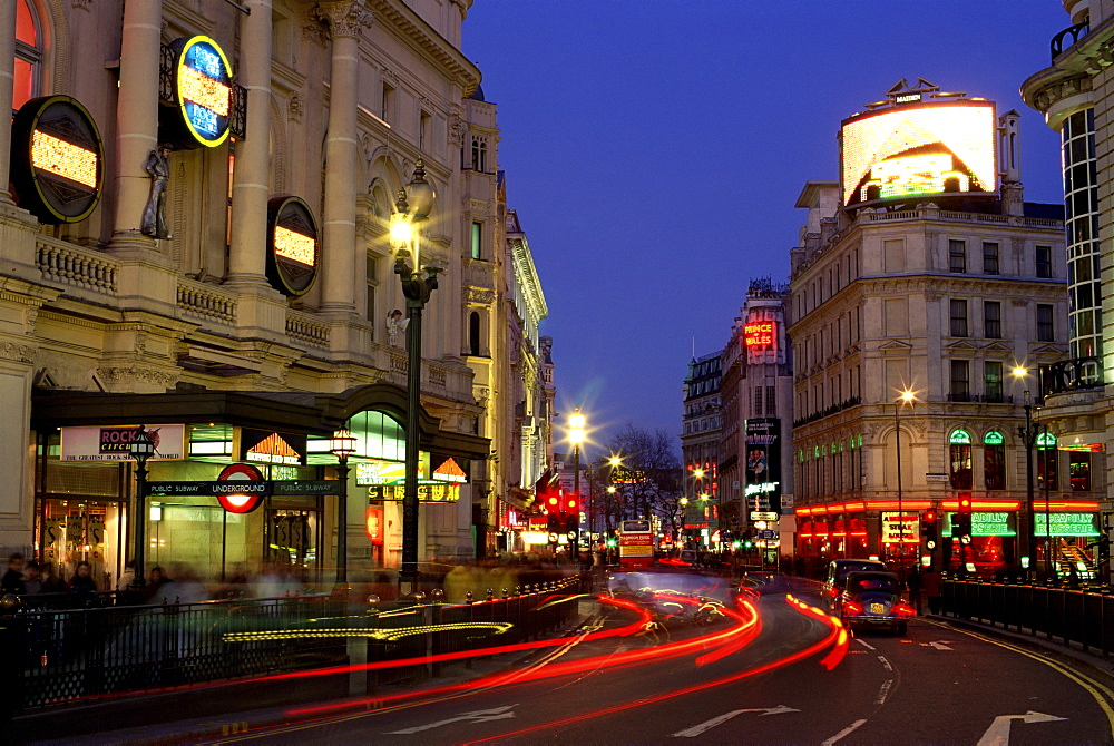 Traffic trails and theatre signs at night near Piccadilly Circus, London, England, United Kingdom, Europe