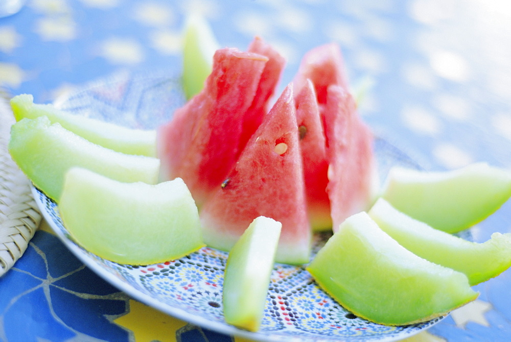 Slices of melon, commonly served as dessert in Moroccan restaurants, Marrakech, Morocco, North Africa - 321-3287