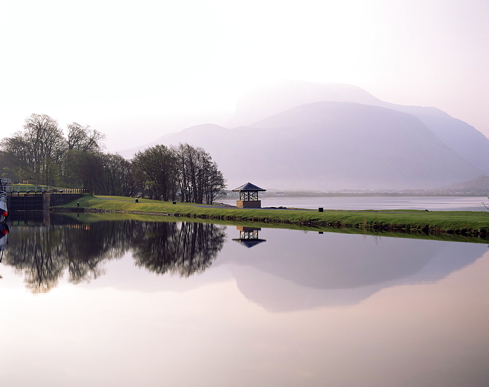 Ben Nevis reflected in the Caledonian Canal, early morning, Corpach, near Fort William, Western Highlands, Scotland, United Kingdom, Europe