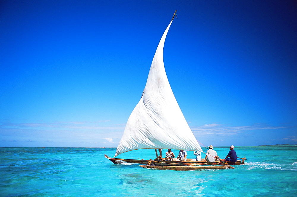 Outrigger canoe with sail on Indian Ocean, off Jambiani, Zanzibar, Tanzania, East Africa, Africa - 321-4095