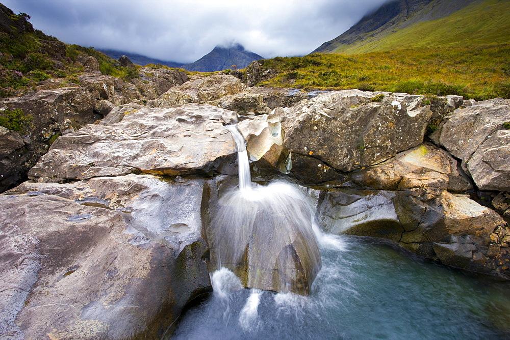 Water cascading over rocks, Fairy Pools, Glenbrittle, Isle of Skye, Highland, Scotland, United Kingdom, Europe